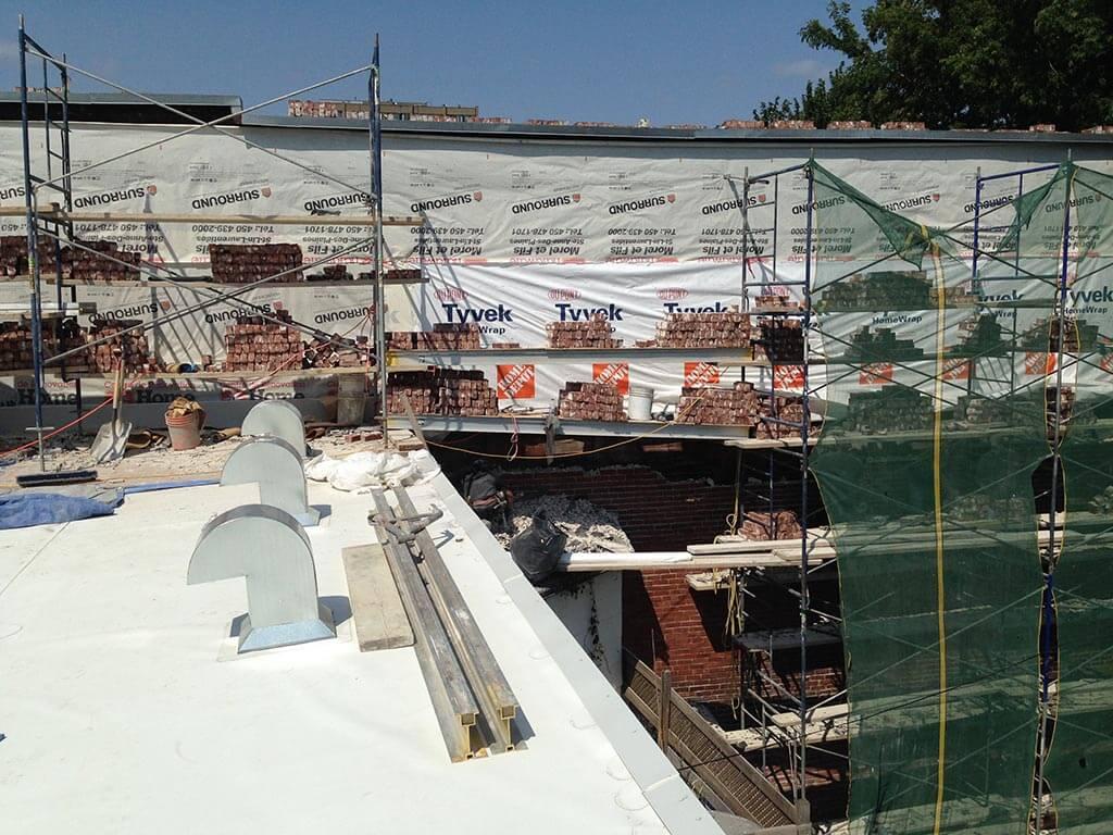 Reconstruction mur de maçonnerie dans Rosemont